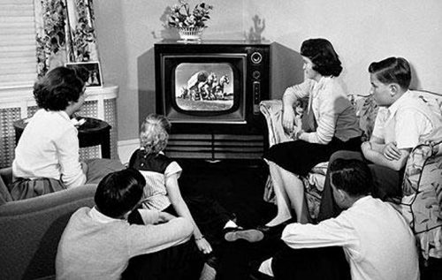 picture of people watching crappy old TV